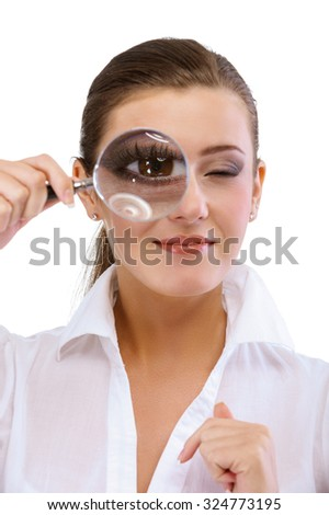 Woman holding a magnifying glass near the eye, isolated on white background. - stock photo