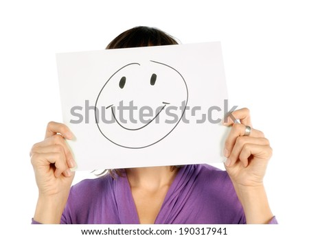 Woman holding a paper with a smiley on her face