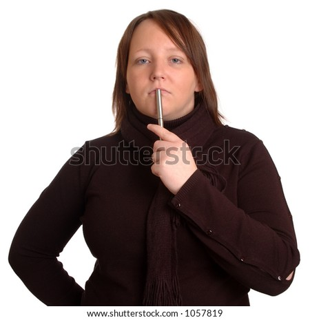 Woman holding a pen, thinking.