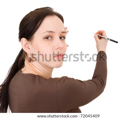 woman holding a pen to write - stock photo