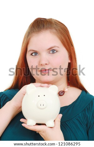 Woman holding a piggy bank - stock photo