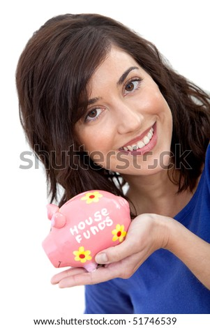 Woman holding a piggybank and smiling isolated over a white background