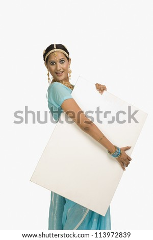 Woman holding a placard and smiling - stock photo