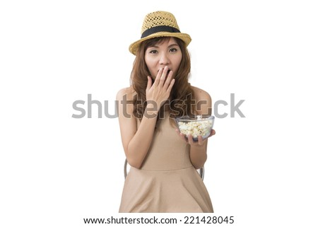 woman holding a pop corn bowl  - stock photo