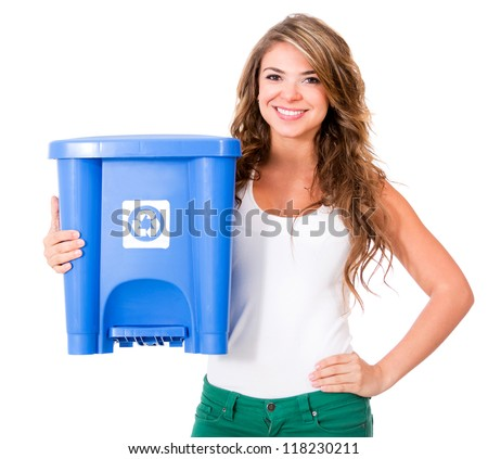 Woman holding a recycle bin - isolated over a white background - stock photo