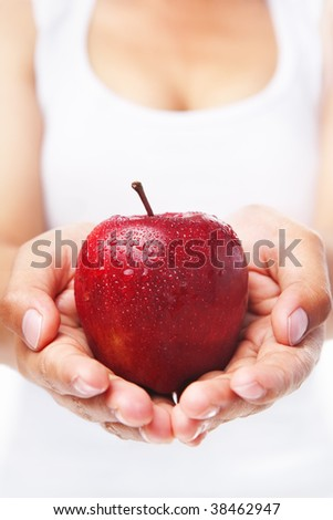 Woman holding a red apple. PS : shallow depth of field