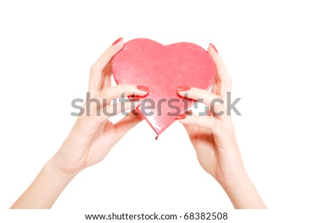 Woman holding a red heart in her hands - stock photo