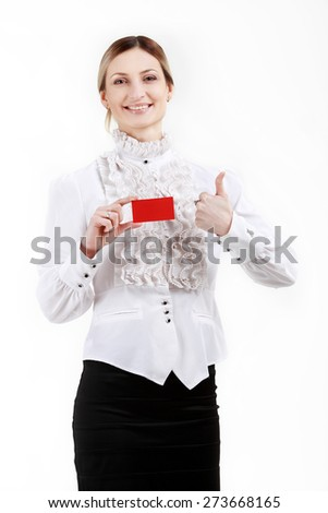 Woman holding a red plastic card - stock photo