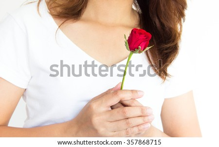 Woman holding a red rose with white background - stock photo
