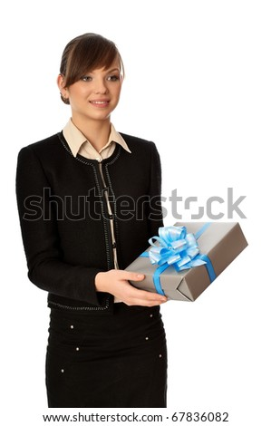 Woman holding a silver box with blue bow as a present - stock photo