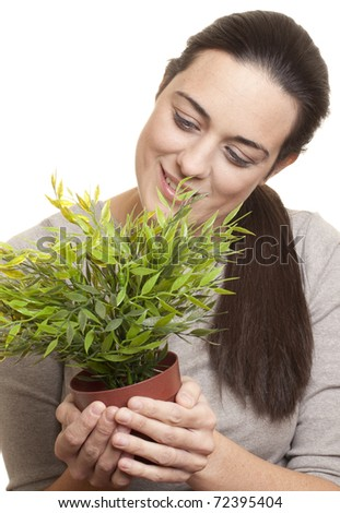 Woman holding a small plant