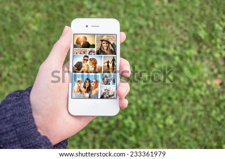 Woman holding a smart phone with collage of several lifestyle images - Phone with unforgettable memories - stock photo