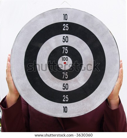 Woman holding a target for you to aim at - stock photo