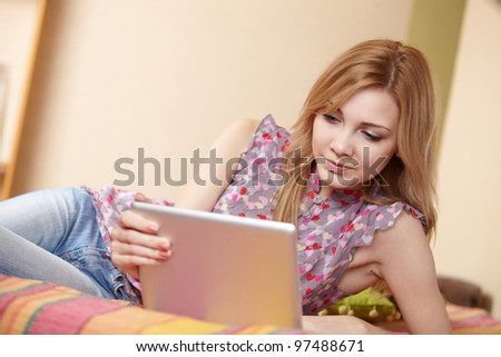 woman holding a touchpad pc - stock photo