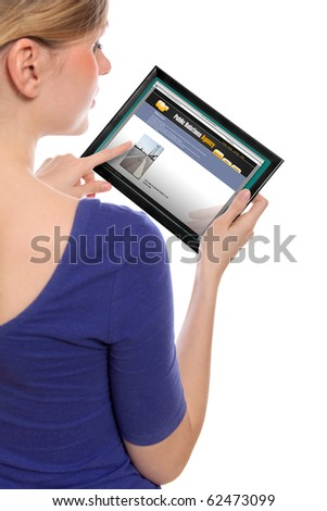 woman holding a touchpad pc, one finger touches the screen and surfing the web - stock photo