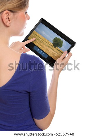 woman holding a touchpad pc showing a movie, isolated on white - stock photo