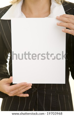 woman holding a white cardboard - stock photo