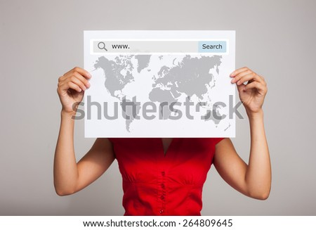 Woman holding a world map with a search bar - stock photo