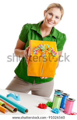 Woman holding a wrapped present isolated on white - stock photo