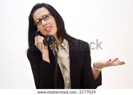 Woman holding an old school phone arguing - stock photo