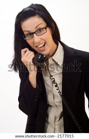 Woman holding an old school phone being surprised