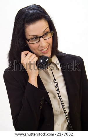 Woman holding an old school phone smiling - stock photo