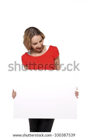 Woman holding and looking at a whiteboard - stock photo