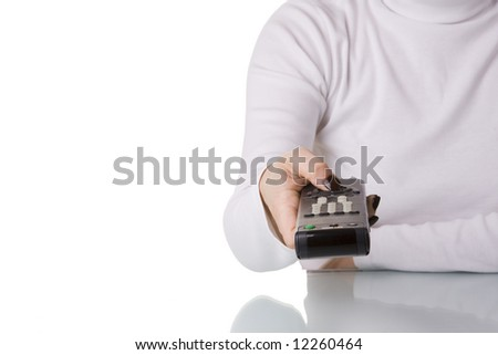 woman holding and pointing a remote control (selective and soft focus) - stock photo