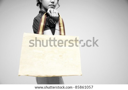 woman holding bag