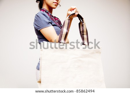 woman holding bag - stock photo