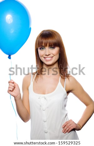 Woman holding balloon