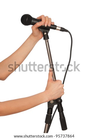 woman holding big black microphone for singing
