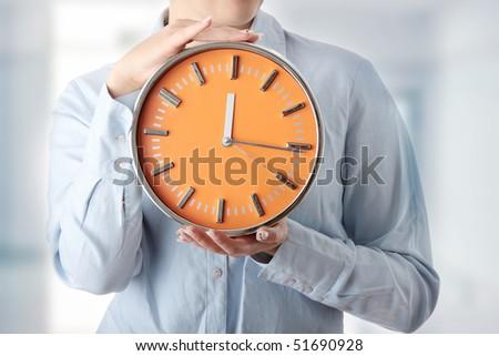 Woman holding big clock - stock photo