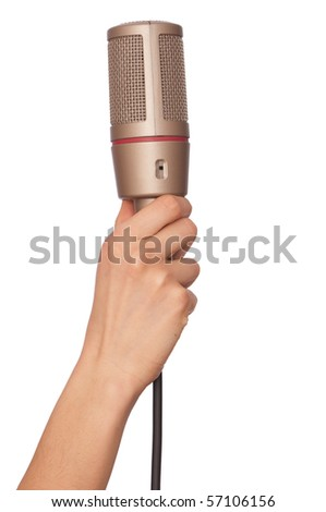 woman holding big professional microphone for singing