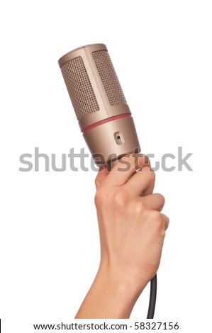 woman holding big professional microphone for singing - stock photo