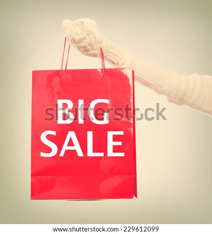 Woman holding Big Sale red shopping bag - stock photo