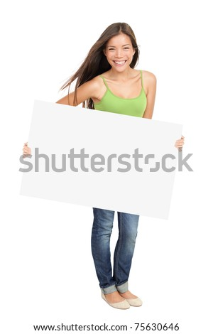 Woman holding billboard sign smiling fresh. Caucasian / Asian woman isolated on white background in full figure. - stock photo