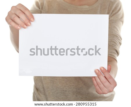 Woman holding blank card close up