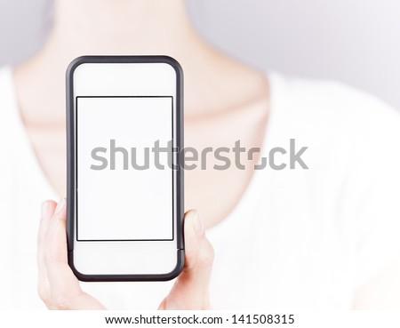 Woman holding blank smart phone - stock photo