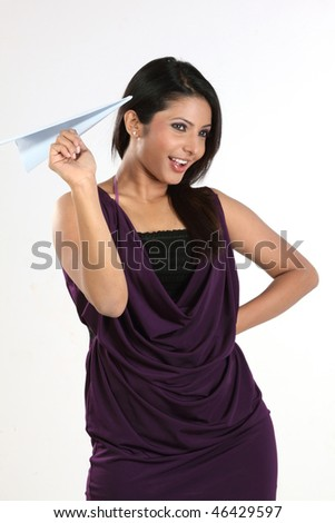 woman holding blue paper plane - stock photo