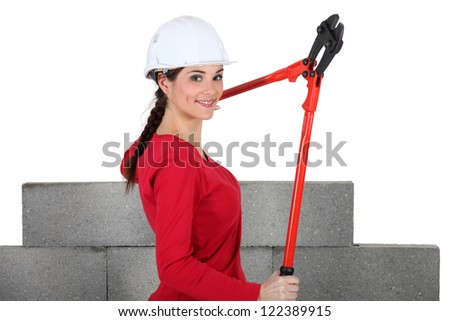 Woman holding bolt-cutters - stock photo