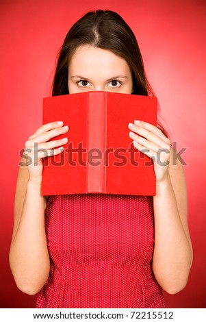 Woman holding book - stock photo