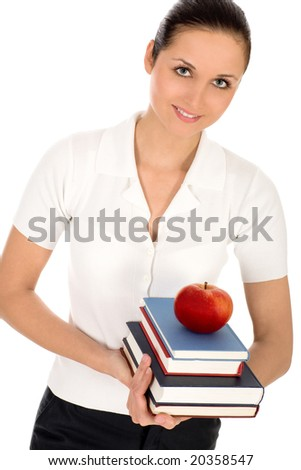 Woman holding books and apple - stock photo