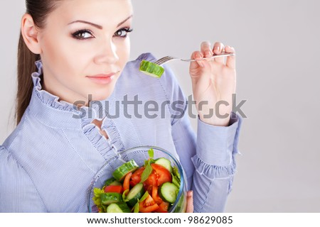 Woman holding bowl of salad isolated - stock photo