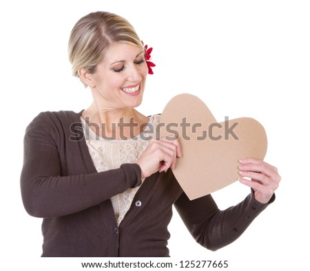 woman holding brown vintage heart close-up isolated on white - stock photo