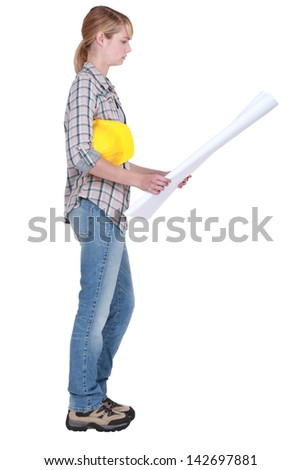 Woman holding building plans - stock photo