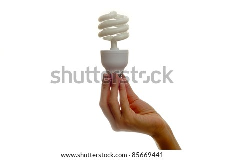 Woman holding bulb over white background - stock photo