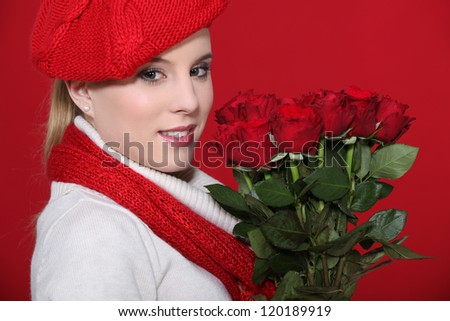 Woman holding bunch of roses - stock photo