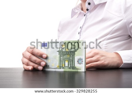 Woman holding cash in euro on desk isolated on white background