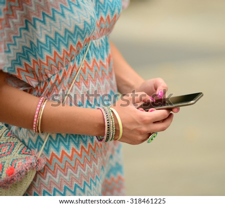 Woman holding cellphone - stock photo